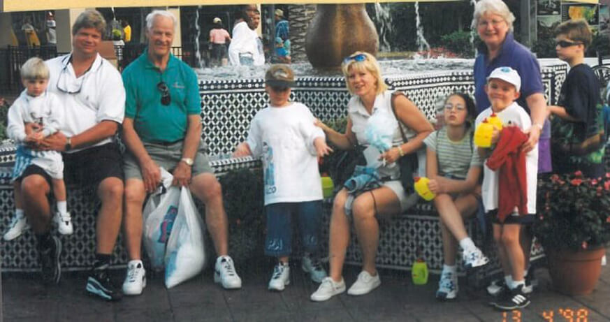 MJS's family pictured alongside The Howes in Disney World