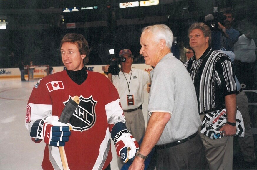 MJS and Gordie Howe rink-side during an international game